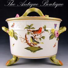 Herend Rothschild Bird Porcelain Lidded Biscuit Box. An outstanding vintage Herend porcelain lidded biscuit box, or cookie jar, in the Rothschild pattern. Beautifully painted with birds, butterflies and insects. Vine shaped handles to the sides, resting on three 'vine' feet. From The Antique Boutique on Ruby Lane Herend China, China Painting, Cookie Jars, Tea Set, Cookies Et Biscuits, Dinnerware, Stoneware, Tea Cups, Chandelier