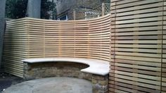 Curved slatted panel fence