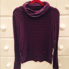 Roxy charcoal & pink striped cowl neck sweatshirt Roxy charcoal & hot pink striped cowl neck sweater. Worn but in good condition besides some very minor pilling. Front pocket. Very soft. 50% rayon, 45% polyester, 5% spandex. Size M. — no trades — feel free to make an offer! Roxy Sweaters Cowl & Turtlenecks