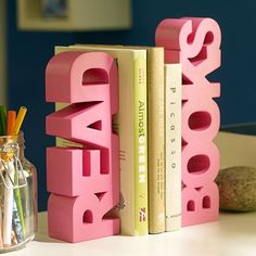 Let's dress it up shall we?  No longer will those grungy, dull textbooks appear to be so distinct with this pair of book ends along-side!