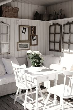 Cozy, Lofty White Living Room Booth and Chairs
