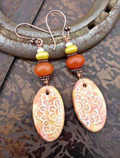 Ceramic mandala flower charms, stone, glass and copper earrings. Orange, yellow, cream.