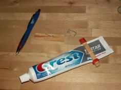 Make a toothpaste squeezer with clothespins and rubber bands