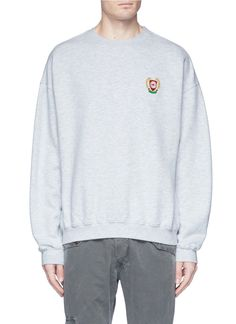 14d1342e Representing Kanye West's signature street vibes, this sweatshirt from Yeezy's  Season 5 is rendered with oversized proportions.