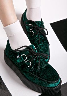 T.U.K. Evergreen Velvet Mondo Viva Creepers live on and rock on. These punk rock throwbacks feature an all over dark green velvet upper, classic D-ring lace up eyelets, embossed detailing all over, thick textured creeper sole, and black piping.