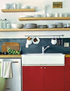 staggered wood open shelving in a somewhat modern nautical style, red Ikea cabinets, awesome horse plate color difference behind sink. Kitchen On A Budget, New Kitchen, Kitchen Dining, Kitchen Decor, Kitchen Colors, Kitchen Sink, Nautical Kitchen, Kitchen Wood, Kitchen White