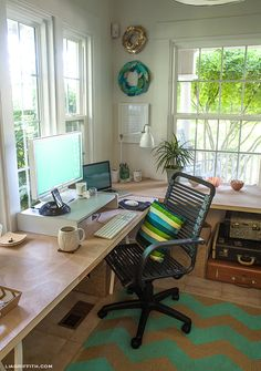 This office, by Lia Griffith, is awesome!  But I am especially inspired by the do it yourself desk surfaces made from doors at Home Depot; and I really want those wood block coasters too!  I've also been meaning to make some of her beautiful paper feather crafts, ever since I saw the first one.  Oh yeah, and her awesome pillow too!  (and whoo doesn't love that adorable West Elm Owl mug??).  -KWA