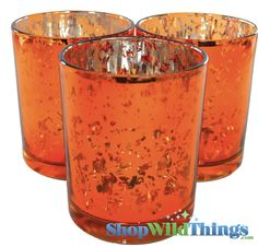 "Our ""Leslie"" round votive Mercury Glass Candle Holders come in a vibrant orange and you'll get a set of 12!  Mercury glass has a random pattern of silver overlay inside the cup, giving the glass a meta"