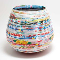 Creatively made of wrapped recycled paper, this yarn bowl from Lantern Moon is the perfect size for a ball of yarn! Each bowl is unique as the paper and printi