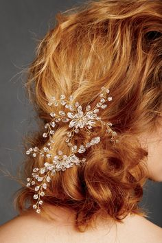 This delicate hair piece adds a special element to this messy updo.  #TurnHeads