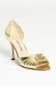This gold Manolo Blahnik pump is flawless! Perfect for a bride.