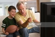 Stock Photo : Father and son watching football