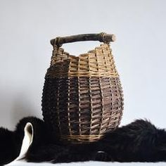 Woven into the shape of a honey pot, this basket looks great next to the fire for storing peat or next to the sofa to keep your favourite blanket close to hand on those chilly winter nights. Colour variations will occur as all of the willow naturally grows in different shades of browns and greens, Diane selects and matches the colours together in her own designs. Birch Branches, Honeypot, Textures And Tones, Spiral Pattern, Irish Traditions, Natural Texture, Basket, Shades, Sofa