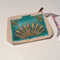 Makeup bag clutch statement wristlet How cute is this!!!!  Super cute little bag that you can use as a makeup bag, clutch, wristlet or more!  Has a beautiful diamond design screen printed on both sides.  Turquoise.  Rough measurements are 8x5 Boutique Bags