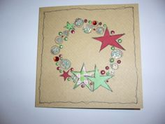 Christmas wreath - JOFY stamp, paper piecing bling and cosmic shimmer glues