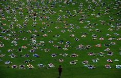 "People take part in ""Yoga On The Hill"" on Parliament Hill in Ottawa, Ontario, on Wednesday, Aug 27. - Sean Kilpatrick/The Canadian Press via Associated Press"