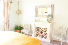 This is an amazingly inspiring remodel done on the CHEAP!  It was done for under $250 total.  Wow.  The Master Bedroom Reveal and Cost Breakdown | The Rooster and The Hen