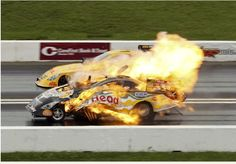 Jim Head's Funny Car explodes in the NHRA Summer Nationals drag races in Topeka, Kansas.