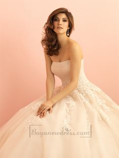 Lace appliques dance across a slightly ruched bodice, which falls to a full skirt of English net.