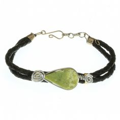 A stylish bracelet featuring a central, polished, light green stone teardrop mounted on a twin, braided, black leather strap, with alpaca silver embellishments. Only £7.99