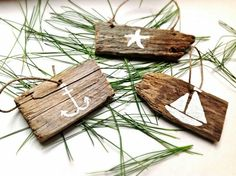 driftwood ornaments with painted nautical symbol painted on it.