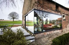 Completed in 2013 in Lennik, Belgium. Images by Tim Van de Velde. Studio Farris Architects was commissioned to convert the complex of house and stables of an 18th century farm located in Lennik, a small town in an...