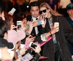 Picture perfect: The blonde beauty was more than gracious as she paused to take selfies with fans