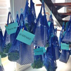 Guest gift bags hanging from the stairs like fishing nets for a 'Under the Sea' theme birthday party styled by Pack A Perfect Party.