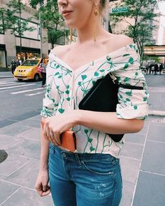 We love this fresh take on the off the shoulder trend, who knew a button down could look just as fierce! What is your favorite way to wear this style? #ootd #AnthroRockCenter