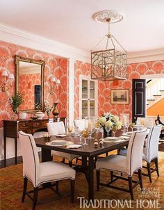 orange and white traditional dining room