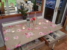 My beautifully restored old farmhouse table, with its original casters. Painted in Annie Sloan old ochre, and finished in a vintage rose oilcloth :) ♥♥