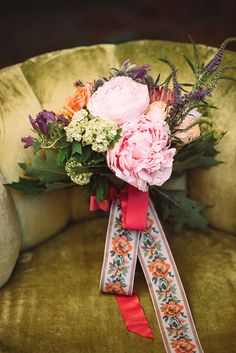 Pink peonies make this bouquet look extra feminine | @veronicavaros | Brides.com