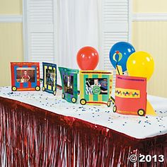 Birthday Train - Put pictures on pieces of construction paper and   wheels on the bottom to create a Train Centerpiece.