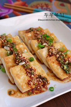 Korean food Dubu Buchim (두부부침). Fried tofu glazed with a sweet and spicy soy-based sauce.