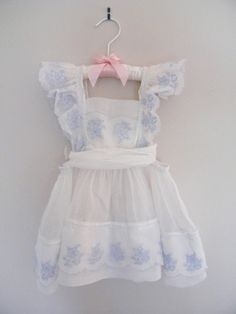 Vintage little girl's pinafore dress, 1950's