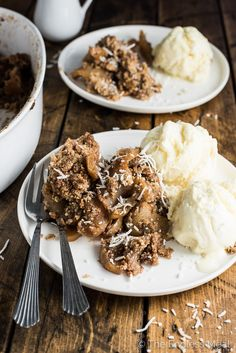 This delicious Healthy Apple Crisp is made without any flour, butter, or refined sugar. Sweet apples, topped with a coconut, pecan, and oat crumble, are baked until soft and sweet. It's an easy to make dessert that is perfect for autumn parties or Thanksgiving dinner. | theendlessmeal.com