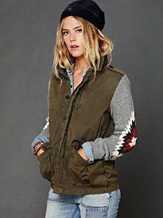 tomboy style, tribal print elbow detail, heather grey sweatshirt, army green vest, jeans
