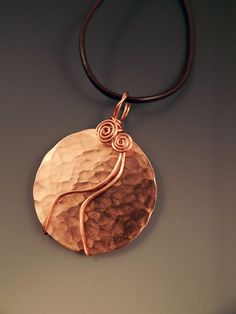 Hammered Copper Disc Wire Wrapped Pendant/Necklace. $22.00, via Etsy.