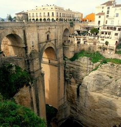 Puente Nuevo Bridge in Ronda, Spain Built on an dramatic isolated ridge, the town of Ronda is split in half by a gaping river gorge, whose sheer cliffs drop over 400 feet on three sides. The gorge is spanned by an eighteenth-century arched bridge, the Puente Nuevo, that looks like it came straight out of an adventure fantasy, while tall, picturesque houses lean from its precipitous edges.