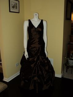 This satin, sable-colored ballgown is one of my favorites! The pickups give this elegant dress a very unique style.