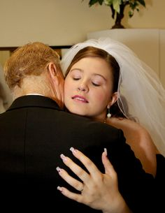 Father and Daughter embrace before wedding