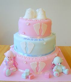 Christening cake with baby's footprints by deborah hwang, via Flickr