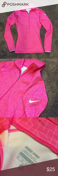 NIKE workout shirt Really cute workout shirt and has a lil stain on the arm Nike Tops