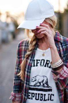 Pair a #GraphicTee with a baseball hat & plaid shirt for a casual outing