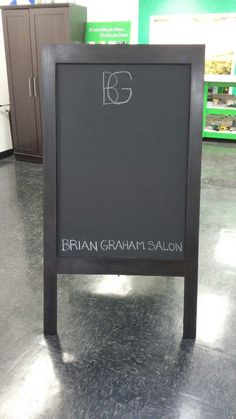 Handcrafted A-frame chalkboard sign, created for a local salon with loving care and expertise. #Signs