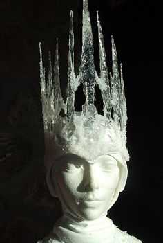 Snow Queen Crown made out of hot glue. Draw image on paper a place beneath wax paper to copy with well running glue gun.