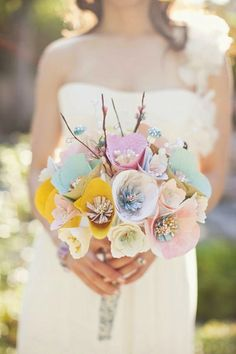 Paper keepsake  Who says all bouquets must be made of flowers? We love the idea of a paper bouquet because you get a lovely keepsake that will last as long as your commitment to each other.
