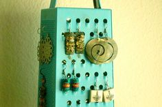 Give a cheese grater a coat of paint, and it becomes a handy earring holder.
