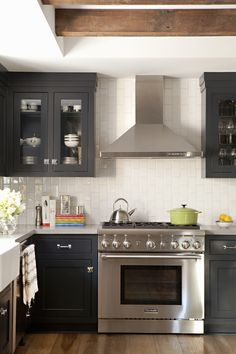 Vertical subway tiles to make space look larger?  draws eye up?   view of stove and range (Cultivate.com)