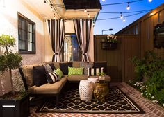 Contemporary Patio: Wonderfully lit outdoor patio area with hanging lights and comfy outdoor seating..